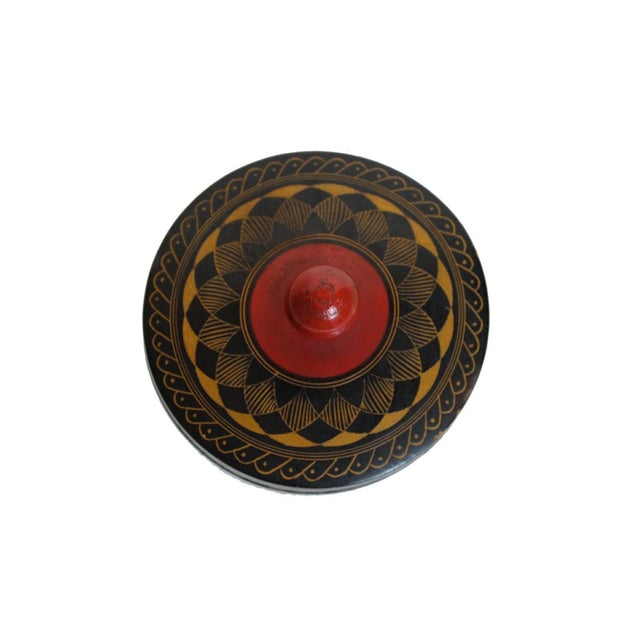 Offered is a small black vintage Indian box featuring a yellow hand painted design.