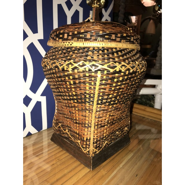 This beauty vintage multicolored brown rattan basket lamp on a wood base newly rewired with brass 3 way socket. Lampshade...