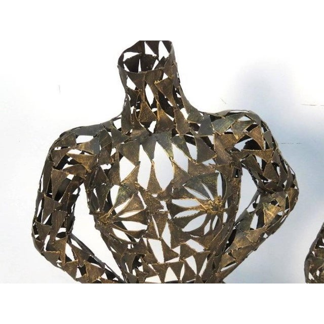 Pair of Mid-Century male and female metal torso sculptures. Very interesting and something you don't see everyday.