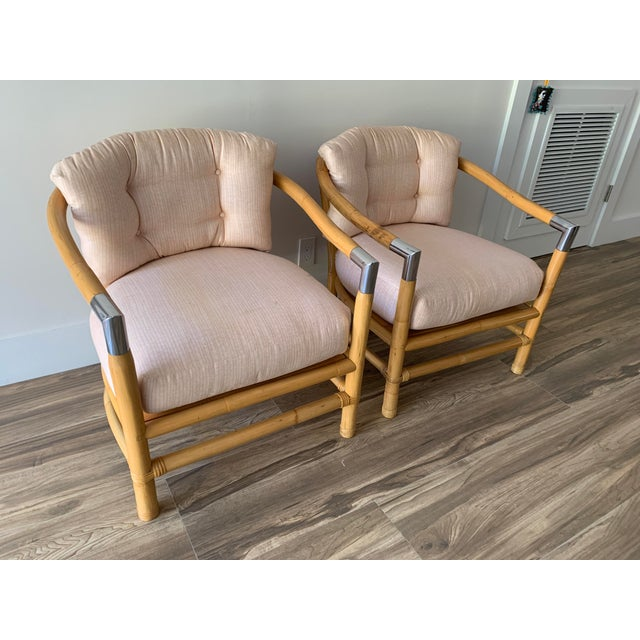 Rare, bamboo and chrome barrel shaped lounge chairs circa 1970's. Sleek chrome accents on hand rests in the style of Tony...