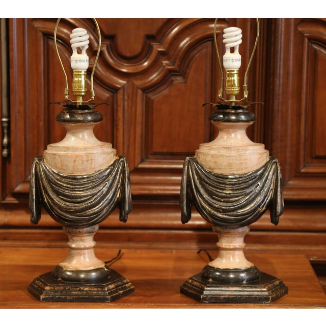Incorporate extra light into a living room or bedroom with this pair of hand-carved and hand-painted wood lamp bases from...