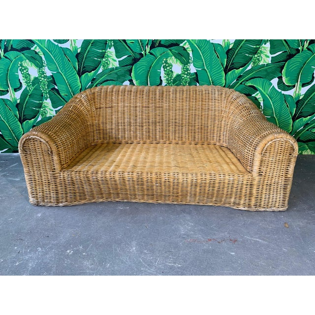 Sculptural wicker sofa in the manner of Michael Taylor or Eero Aarnio. Good vintage condition with minor imperfections...