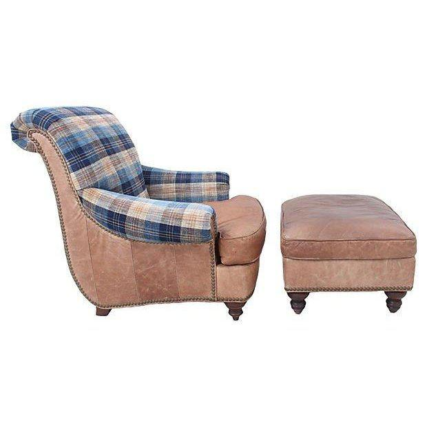 A leather lounge chair and ottoman by Lexington Furniture. The seat back and scrolling arms are upholstered with Lee...