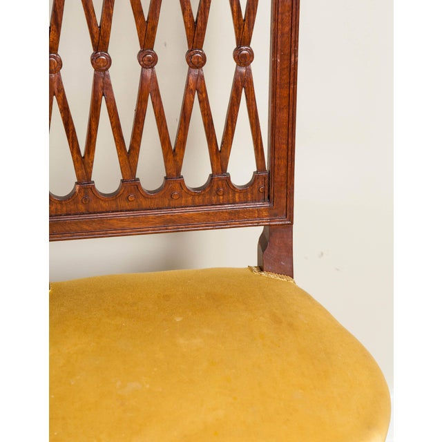 Six mahogany side chairs with golden yellow upholstered seats, 20th century. Perfect for a traditional style home.