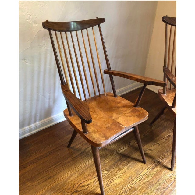 """Pair of George Nakashima style """"New"""" armchairs. Mix of burled wood with walnut, hickory spindles back and saddle seat. One..."""