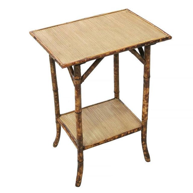 Antique tiger bamboo pedestal side table with rice mat top and a secondary bottom shelf. Restored to new for you. All...