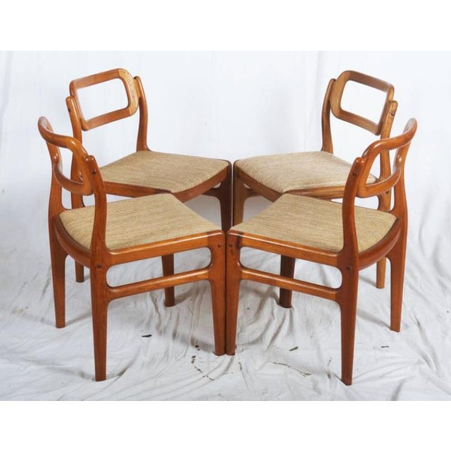 A set of four teak dining chairs made in Denmark in the early 1960s. They are designed in a style reminiscent of Johannes...