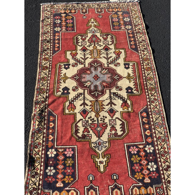This is a vintage Turkish rug. The piece was produced in the 1950s.