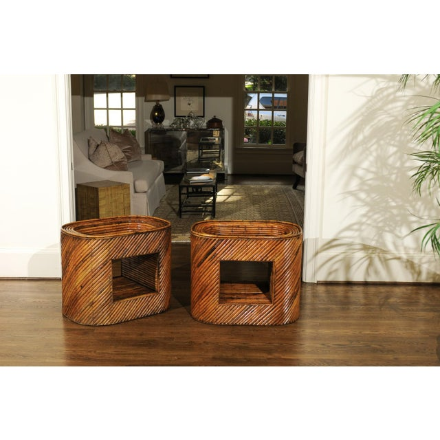 A stunning pair of restored bamboo display end tables, circa 1975. Stout mahogany frame construction completely veneered...
