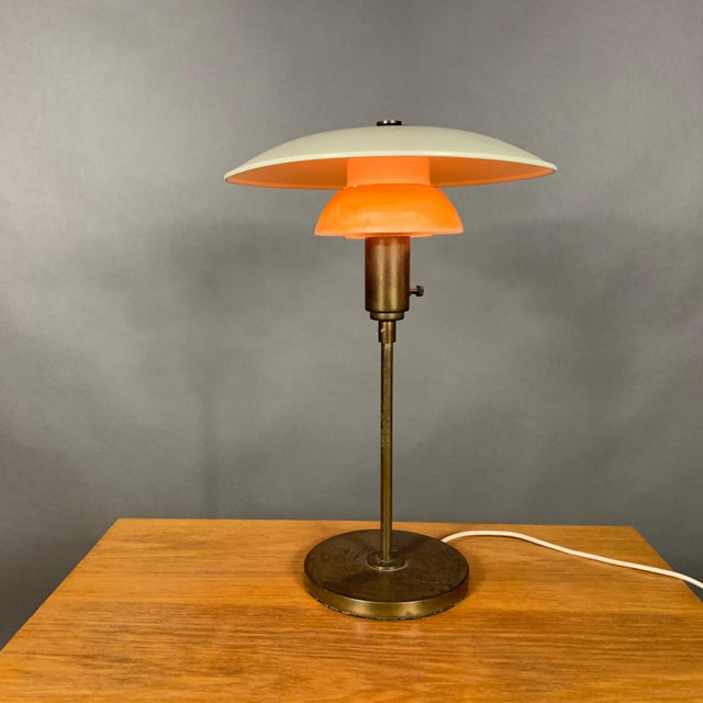 Lyfa was founded in 1924 and moved manufacturing to the Copenhagen area in the 1930s, producing table lamps inspired by...