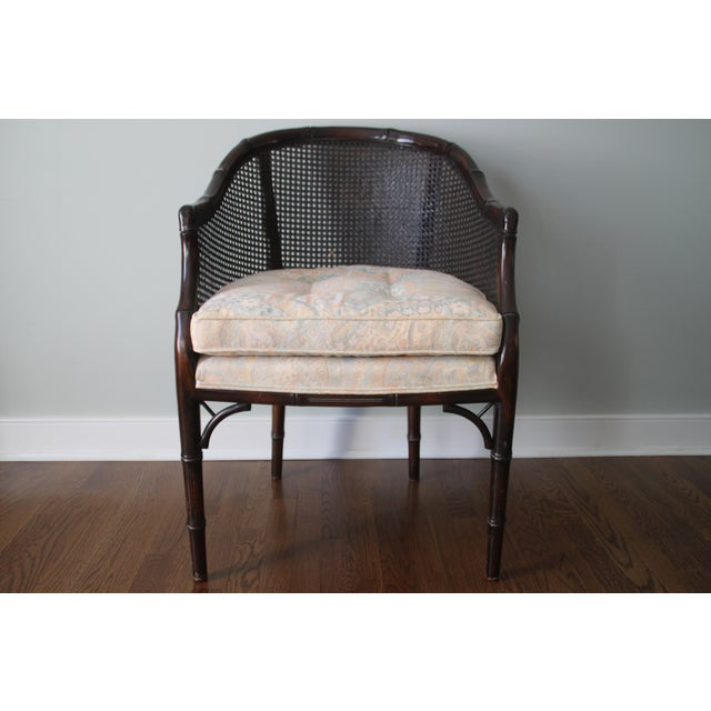 Barrel back chair with caning and bamboo detailing. Caning is overall in good shape. Chair has a few nicks and scratches...