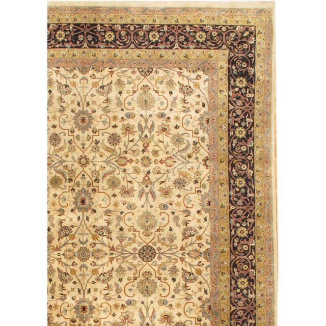 Hand-knotted Tabriz design rug made with 100% pure lamb's wool. From Pakistan.