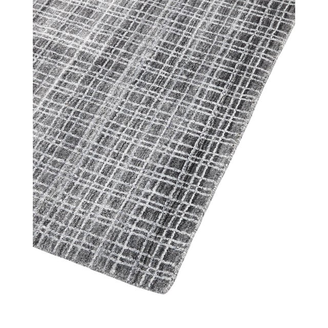 Color: Charcoal. Made in: India. Fresh, spirited, and above all, luxurious, the rugs of the Modern collection can...