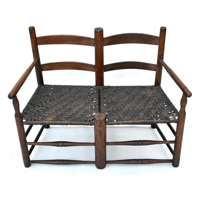 A fantastic and rare late 1800s wood and hickory woven seat settee, very solid and sturdy. A primitive beauty.
