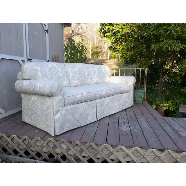 Item offered is a beautiful custom built light blue on Ivory silky-blend Damask formal sofa. It sits 3 people with 6 loose...