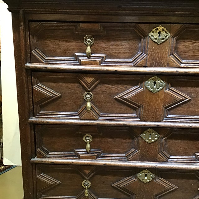This is a great English chest from the 1700s it's style is Jacobean has beautiful brass pulls and lock escutcheons all the...