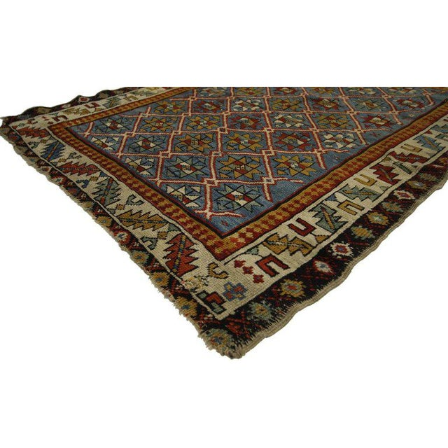 77146, antique Russian Caucasian Shirvan rug with diamond lattice. With its perfectly worn-in charm, pop of color and edgy...