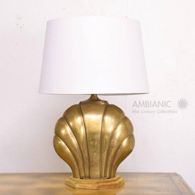 For your consideration a vintage or antique table lamp in the shape of a sea shell in cast brass, mounted in original wood...