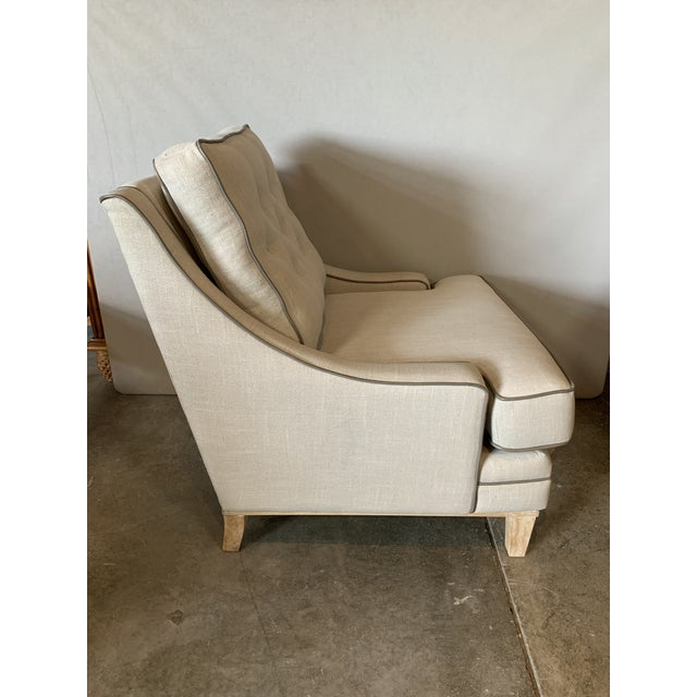 Taking inspiration from todays most stylish interior designers, this handsome chair features light taupe linen upholstery...