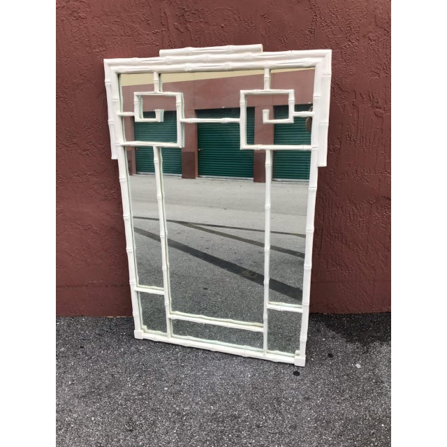 This is a Stunning mirror in terms of design, color and Condition. A vertical faux bamboo and Greek Key mirror done in a...
