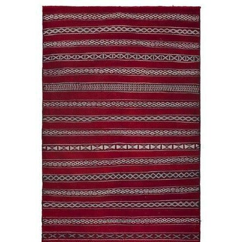 One-of-a-kind hand woven rug in the tick pile style of the Atlas. It is marked by simple Berber designs and motifs are...