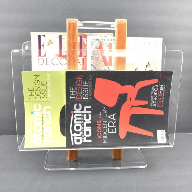 Stunning Lucite or acrylic magazine rack, stand, holder designed for Grosfeld House. Thick plexiglass construction...