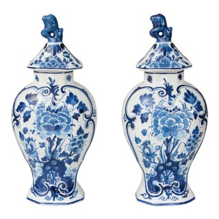Delft Dutch Faience Floral Lidded Vases - a Pair For Sale