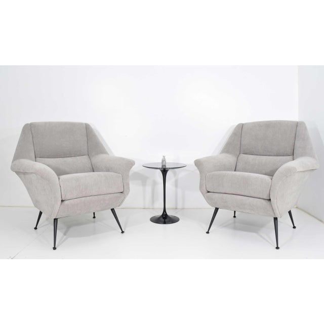 Italian Gigi Radice lounge chairs in a pale gray microfiber. These can be reupholstered to open up the back and eliminate...