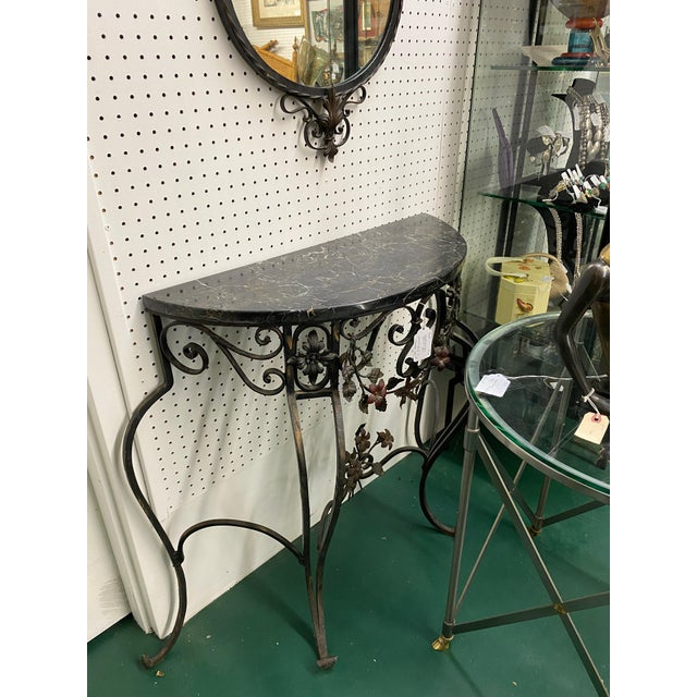 Early 20th C hand wrought iron console table & mirror set. Some original paint remains. Table has black marble top. No...