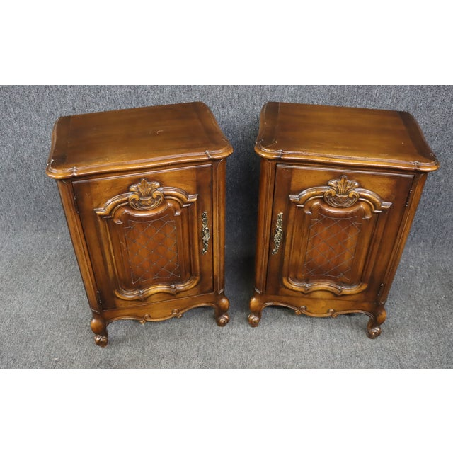 A pair of Louis XV style nightstands, made of cherry , single door with carved raised panel , brass hardware, single shelf...