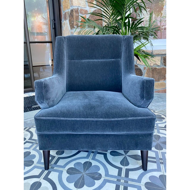 Four beautifully crafted club chairs by Studio Van Den Akker are covered in Donhgia charcoal mohair fabric.