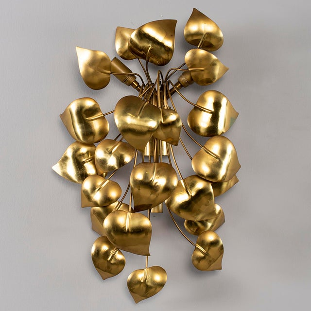 Circa 1970s large wall sconce of gilt metal with heart shaped leaves and three candelabra sized sockets. Attributed to...