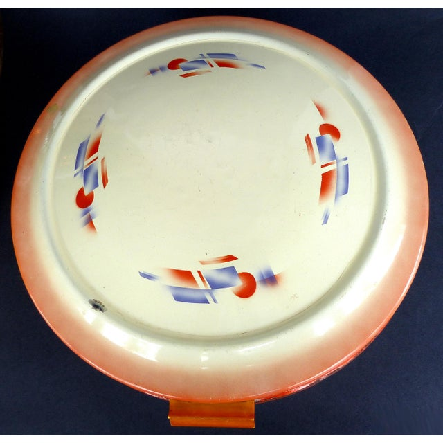 Offered for sale is a 1930's-1940's German enamel bread box with a flip open hinged lid. The box functions but does show...