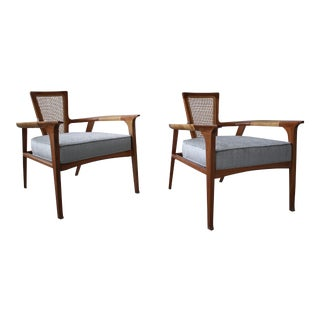Pair of Mid Century Walnut and Cane Lounge Chairs by William Hinn For Sale