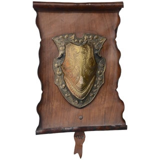 Vintage Bronze Shield on Rustic Leather Scroll Wall Hanging For Sale