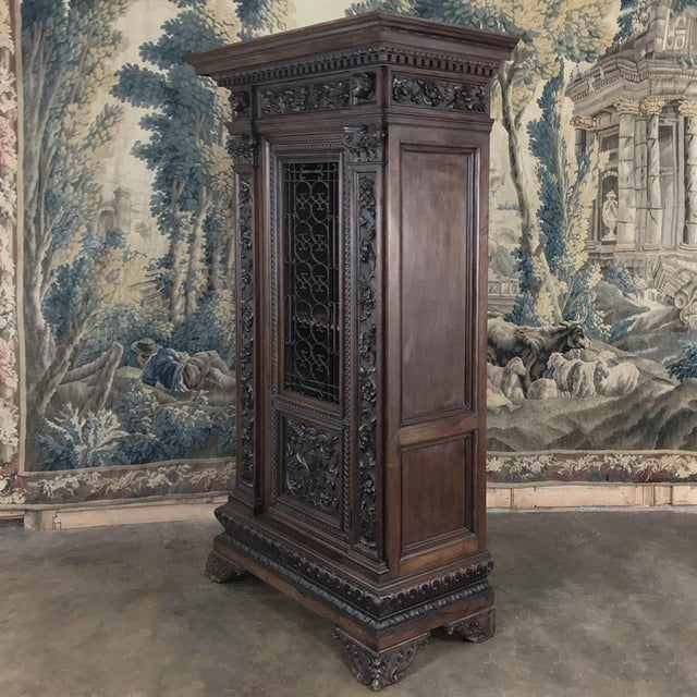 Antique Italian Renaissance Walnut Curio Cabinet is the perfect vertically oriented display case for your cherished family...