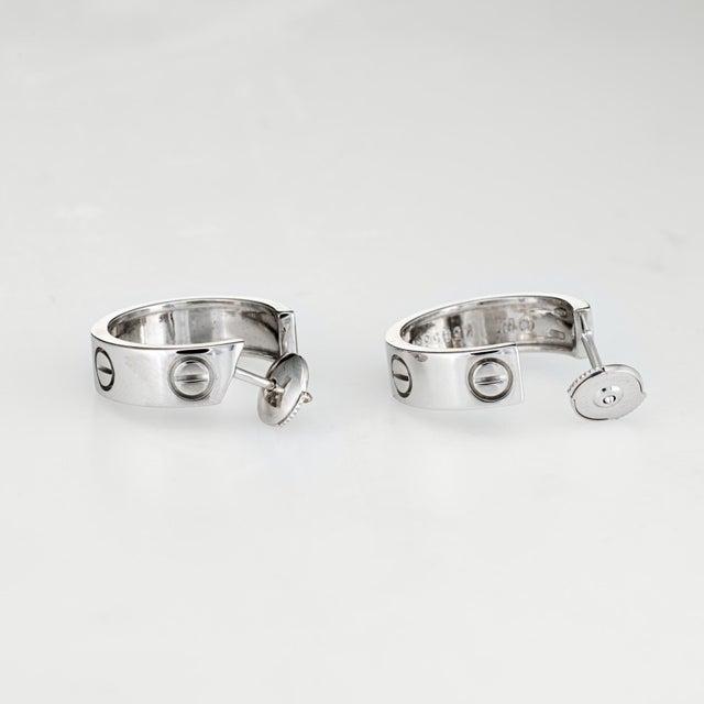 Elegant pair of Cartier love earrings, crafted in 18k white gold. The petite hoop earrings sit nicely on the earlobe. The...
