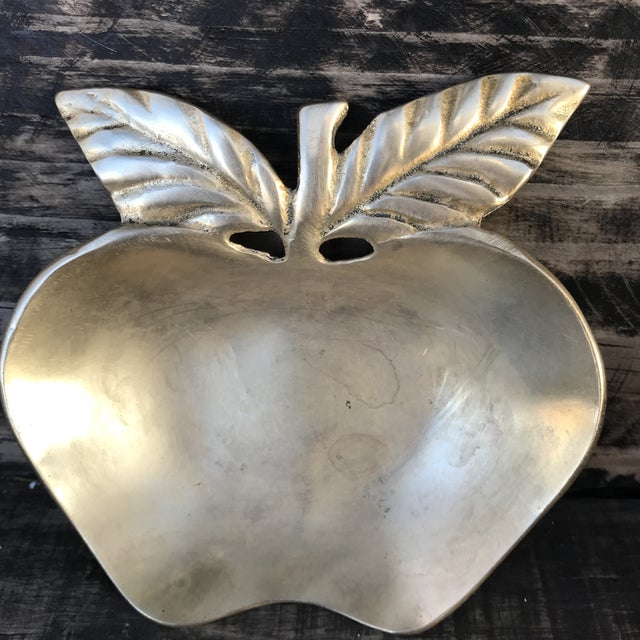 This solid brass apple with stem and leaves is The cutesy catchall. Nice sized and high quality this vintage brass piece...