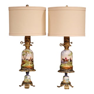 Pair of 19th Century French Painted Porcelain & Brass Oil Lamps With Hunt Scenes For Sale