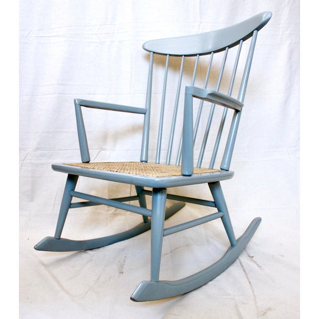 Danish Modern rocking chair with cane seat. The chair has been painted a pale blue, and is in excellent condition.