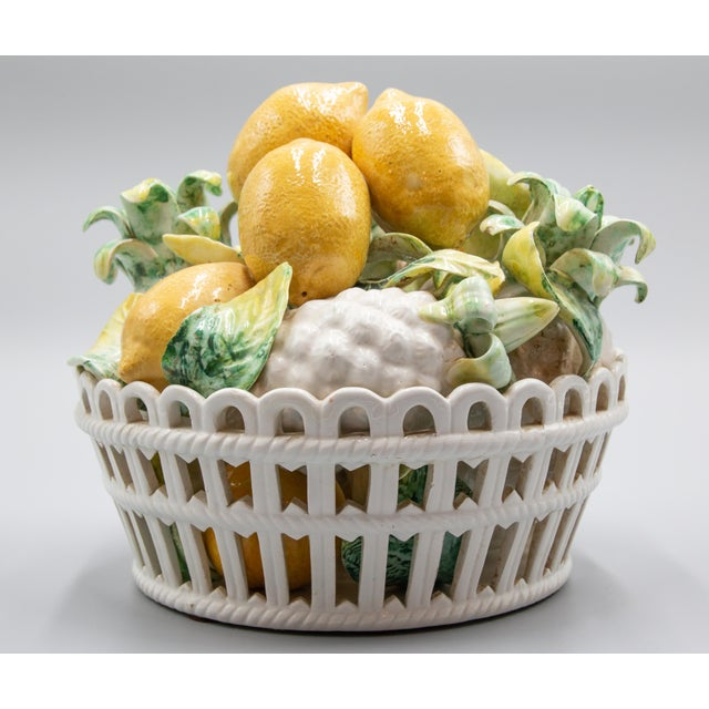 "Stunning Mid-Century Italian majolica basket of lemons and pineapples centerpiece. Marked ""Made in Italy"" on reverse...."