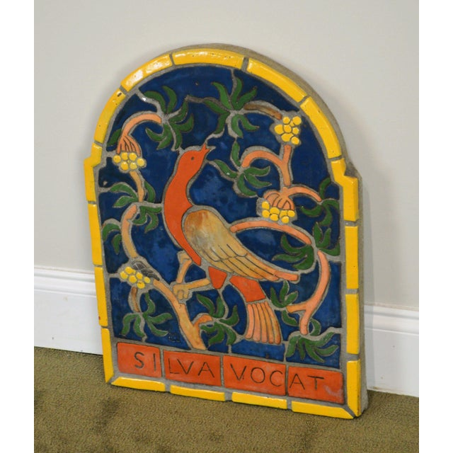 High quality vintage genuine Mercer tile plaque of a red bird on a branch. The piece was made in the 1960s.