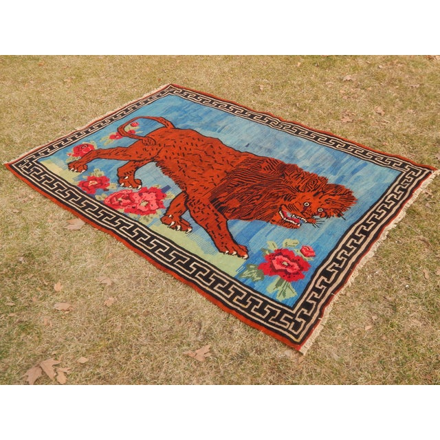 A vintage hand-knotted Gabbeh rug with a pictorial and lion and floral design. This rug has a very soft pile, natural...