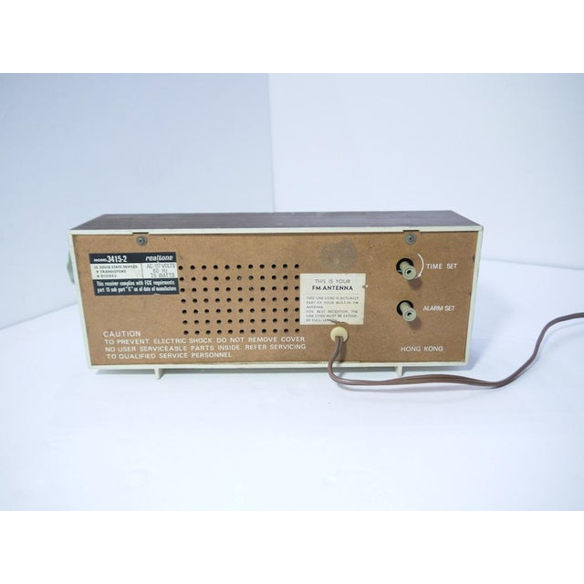 Stylish retro clock radio had great Mid-Century vibe. Clock in good working order, however radio does not function.