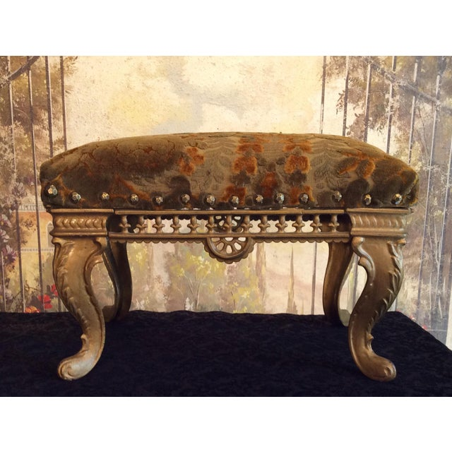 This is a lovely cast iron Gold Footstool with a reticulated skirt and cabriole legs. It is covered in avocado and rust...