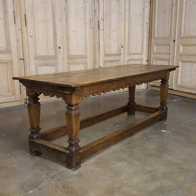 This handsome 19th Century Oak Drapery Table features a lovely scalloped apron, a single drawer for scissors, and tapered...