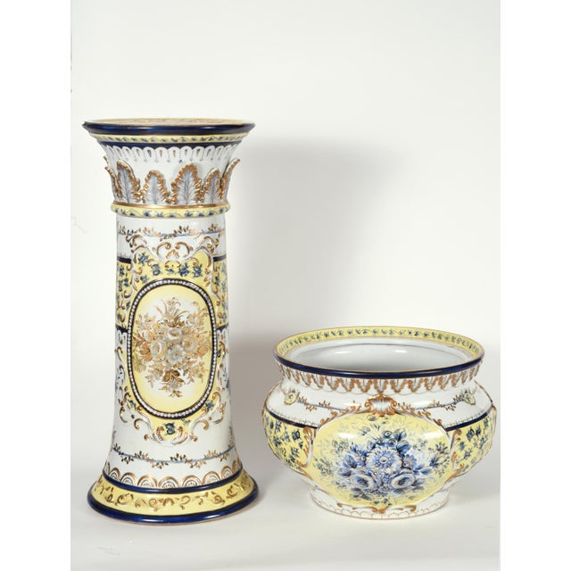 French neoclassical style porcelain plant stand with cachepot decorative set. The pieces are featured a gilt floral and...