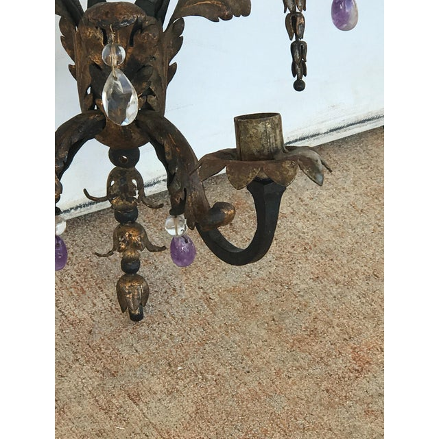 Pair of 19th C. French gilded hand forged sconces mounted with rock crystal and amethyst drops. Ca 1830. Unwired.