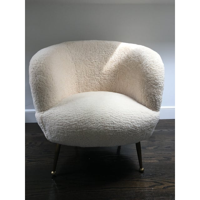 Brand new premium New Zealand sheepskin Scandinavian chair with brass legs by Regina Andrew