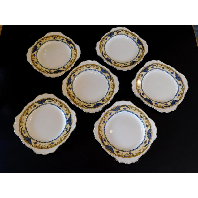 This sweet set of dinner plates feature a unique shape with gold rim and the sweetest blue bird detailing! (stamped Made...